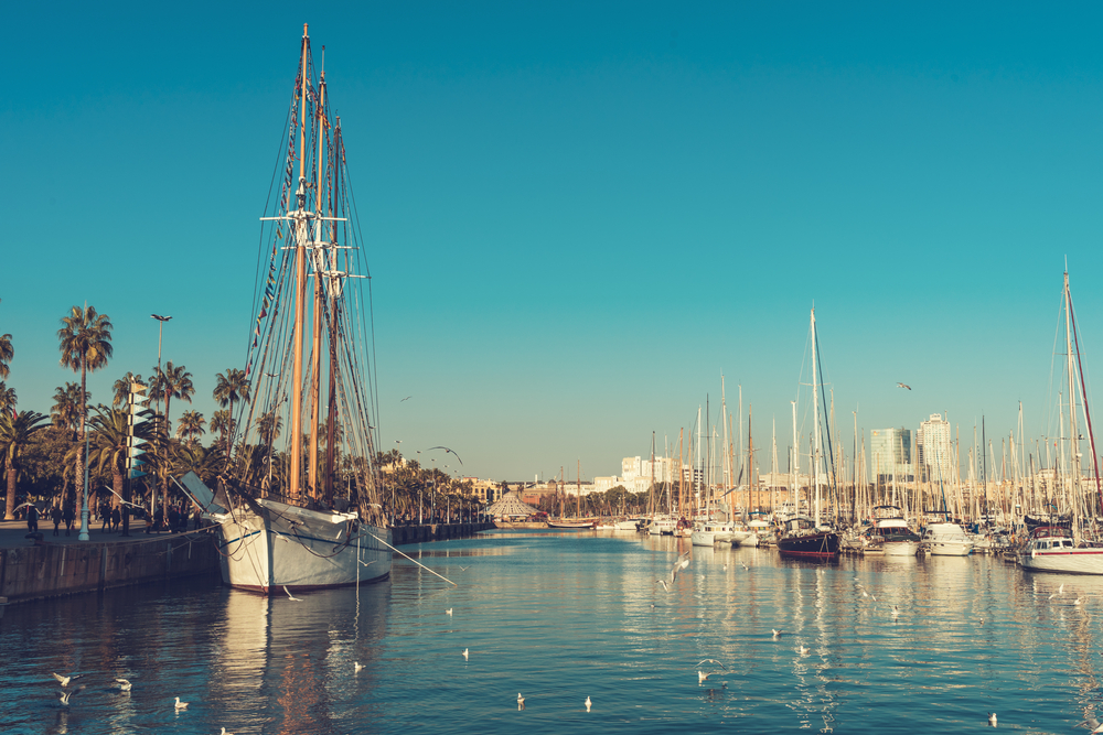 sailing boat on barcelona harbor at sunny day